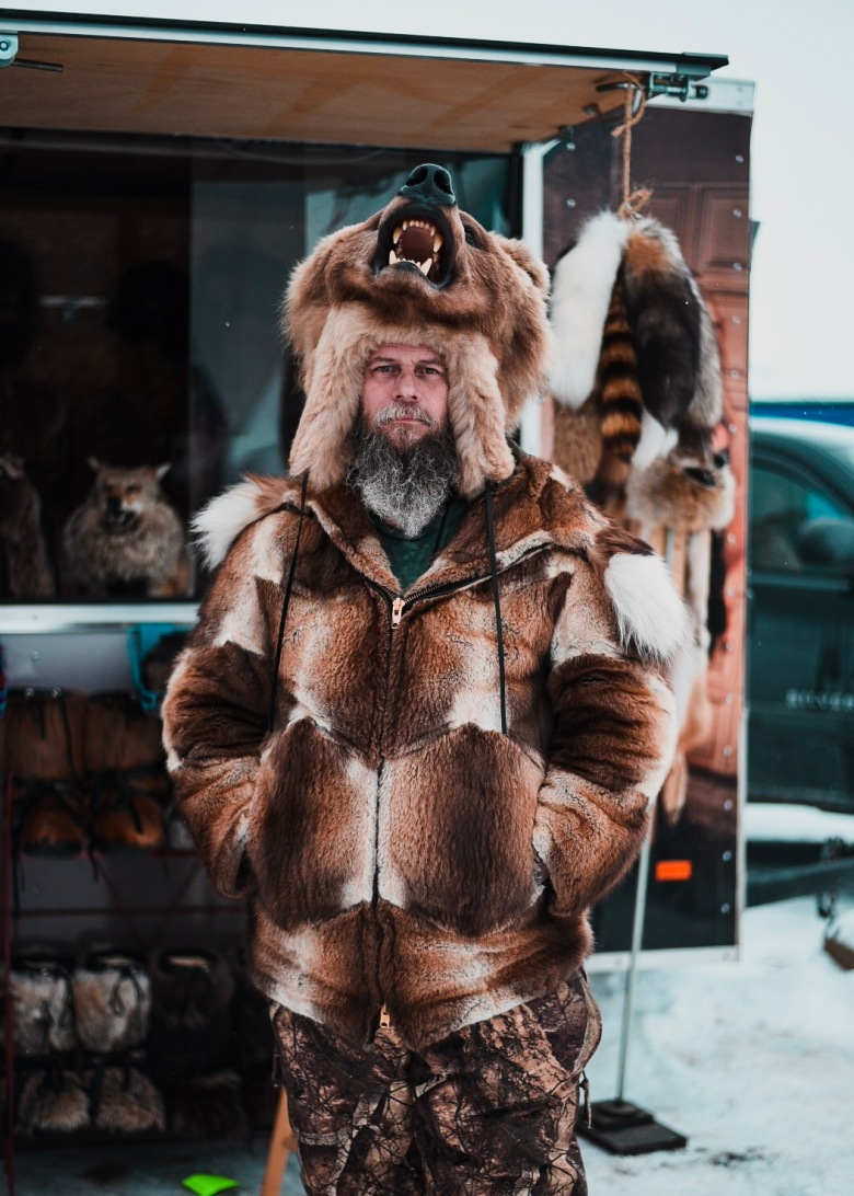 Man dressed in bear outfit from Wildlife Minnesota