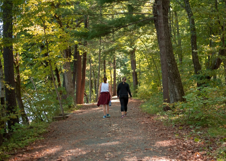 Women hiking on Riverside Trail at William O'Brien State Park