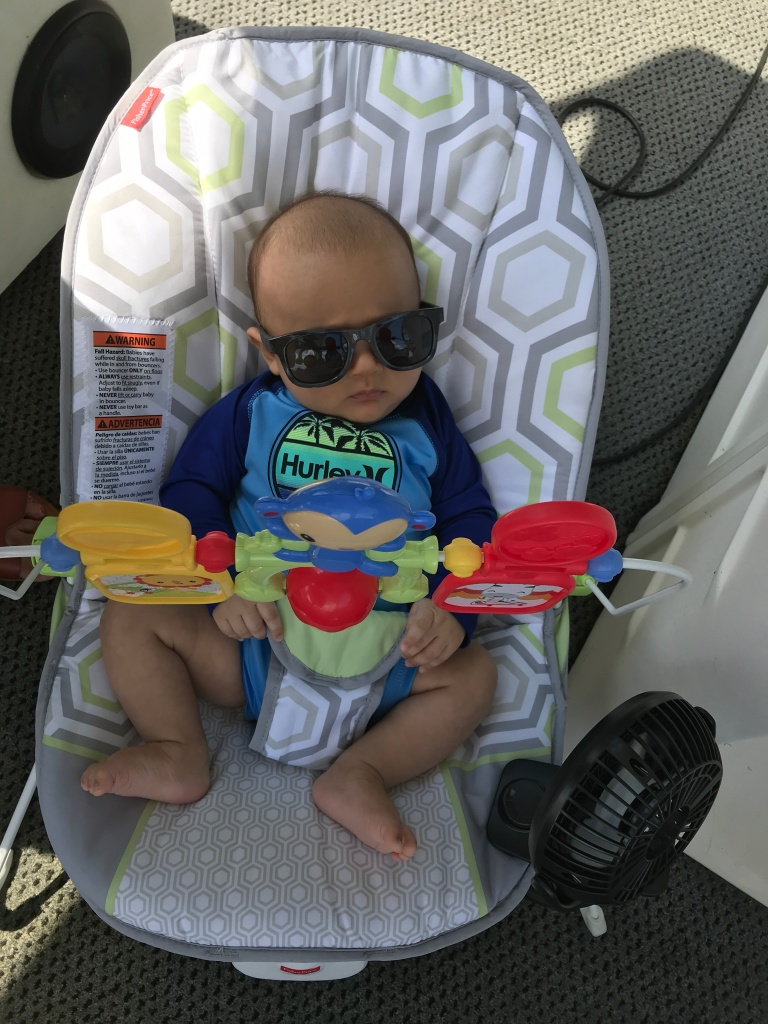 Baby relaxing on boat