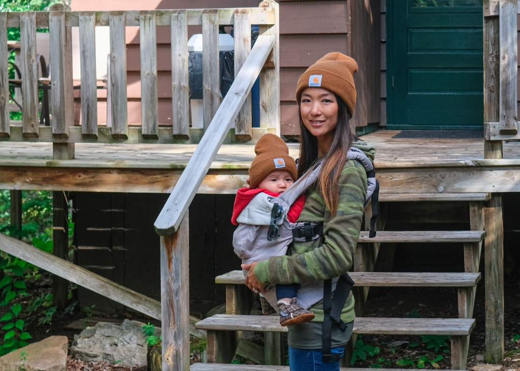 Front pack carrier with baby at cabin in the Boundary Waters